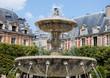Place des Vosges in Paris (France). Fountain with the lions.