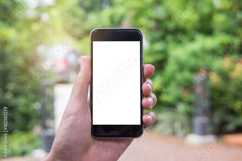 Poster Close up of a man hand holding smart phone with blank screen mobile in gargen