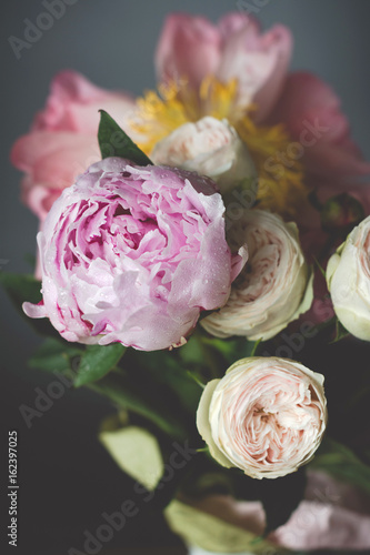 Peonies and roses bouquet. Shabby chic pastel colored wedding bouquet. Closeup view, selective focus