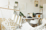 White hammock with golden pillows