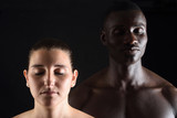 portrait of a mixed couple with eyes closed on black - 162410461