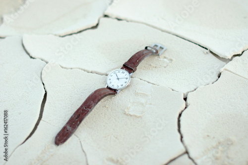An old watch in the desert Poster
