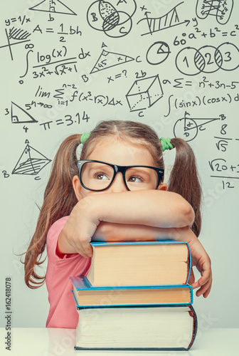 beautiful cute little genius girl with books  Math formulas