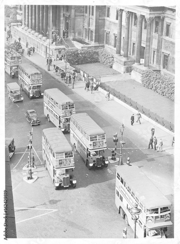 Poster Buses in Trafalgar Square  London . Date: 1945