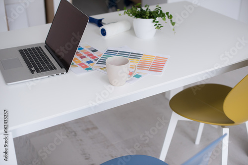 laptop on the table Poster