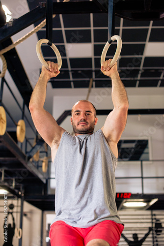 Strong man on gymnastic rings Poster