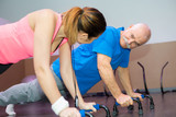 Fototapety senior man with smiling female fitness trainer