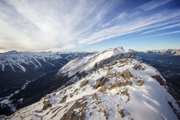 View to a deep winter valley from top of the high mountain ridge, Banff national park, Canada © Jan