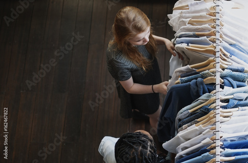 Teenager girl selecting a dress