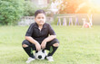 obese fat boy soccer player sit on football