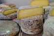 Lot of cheese at local  market cheese store. France