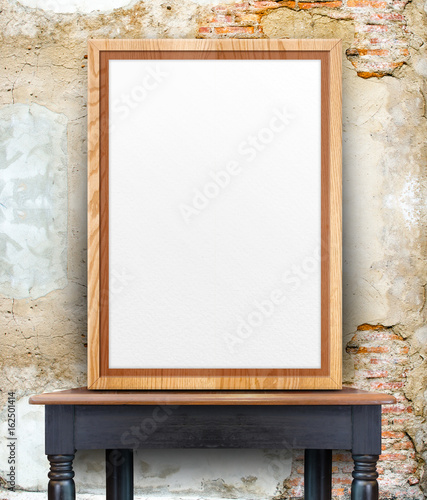 Blank Wooden Photo Frame Leaning At Grey Grunge Concrete Wall On