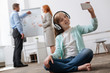 Passionate creative child having fun in the office