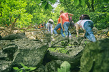 Teen tourists climbing to rocky mountain