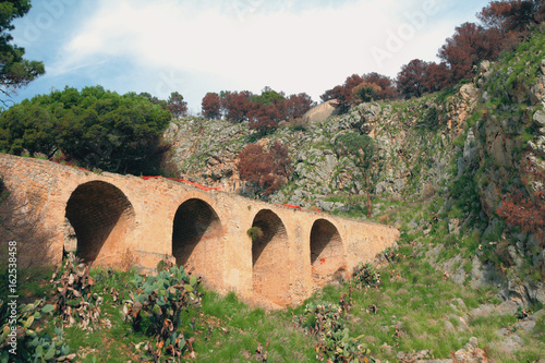 Stone arch bridge, Monte-Pellegrino mountain. Palermo, Sicily, Italy
