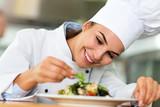 Female chef in kitchen  - 162548807