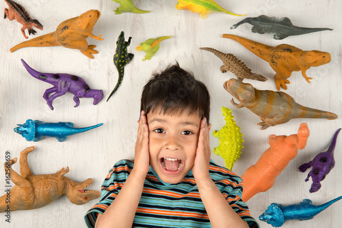 Boy of dinosaurs, delighted with a large number. Poster