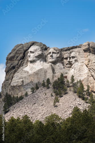 Vertical Side view of Mount Rushmore with sunlight Poster