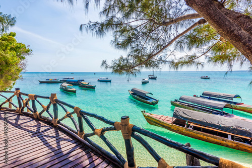 amazing landscape with turquoise ocean and african boats from a terrace of a hotel