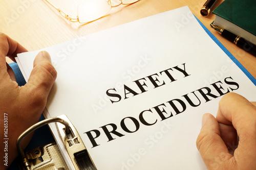 Safety procedures in a blue folder. Work Safety concept.