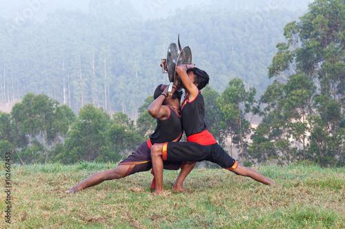 Fighters performing Weapon Combat during Kalaripayattu Marital art demonstration Poster
