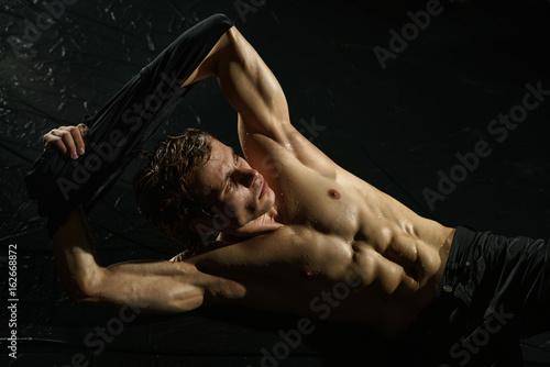 Poster Athletic man taking shower studio portrait