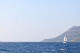 Several windsurfers sail across the channel near Korcula - 162715446