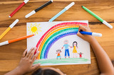 Child drawing happy family - 162740408