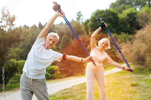 Joyful active people doing physical exercises
