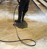 Cleaning with pressure water the pavement of the city streets - 162764464
