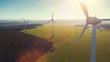 Leinwanddruck Bild - Windmill at windfarm on a sunny summer day