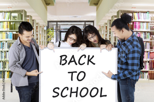 Students holding text of Back to School