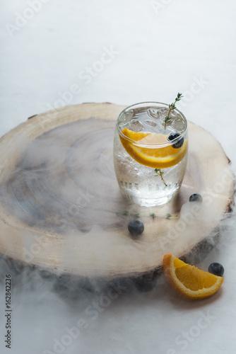 Fresh cocktail with Lemon soda, lime, lemon on the table