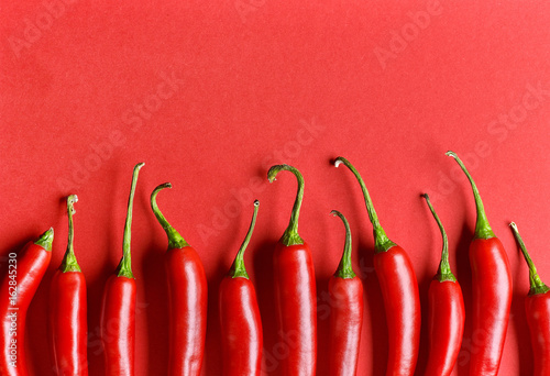Plexiglas Hot chili peppers red chili pepper