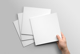 Blank square photorealistic brochure mockup on light grey background.  - 162860231