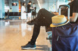 Young traveler using smartphone while waiting at the airport