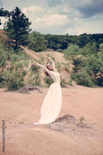 Elegant bride posing outdoor.