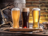Glasses of beer and ale barrel on the wooden table. Craft brewery. - 162886291