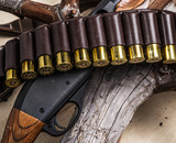 Pump action shotgun, 12 guage cartridge  and hunting knife. - 162886601