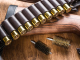 Pump action shotgun, 12 guage cartridge and hunting knife. - 162886602