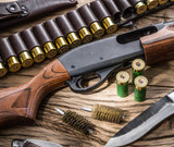 Pump action shotgun, 12 guage cartridge and hunting knife. - 162886603