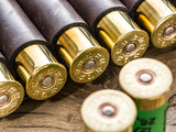 Hunting cartridge for pump shotgun on the wooden table. - 162886629