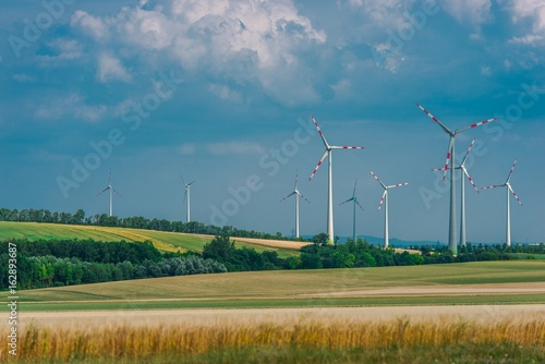 Fotobehang Blauwe jeans Countryside with Wind Turbines