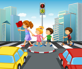 Children crossing street in city