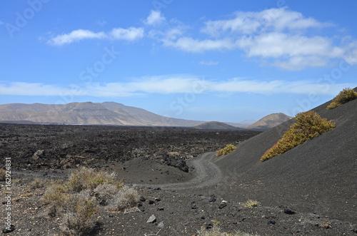 Volcanic moonscape in Timanfaya National Park Poster