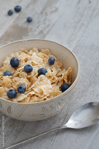 close up view of bowl full of muesli on color back