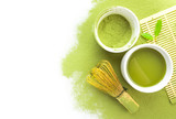 Fototapety Green matcha tea in a bowl and bamboo whiskon isolated on white,top view