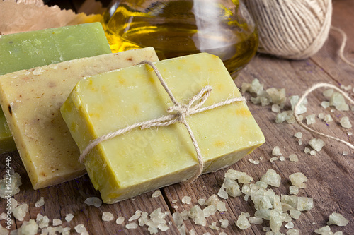 Poster Collection of handmade, natural organic soap and cosmetic oil on wooden background