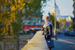 Young girl walking in Paris on a sunny fall day