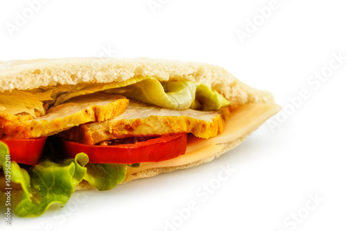 Healthy lunch. Bread pita with a filling of chicken, cheese and salad isolated on white